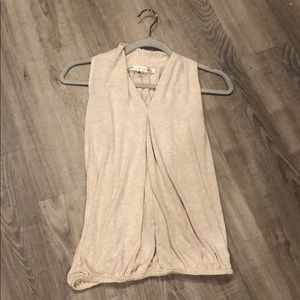 Loose fitting cream strapless shirt